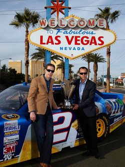 Brad Keselowski and Paul Wolfe in front of the Las Vegas sign
