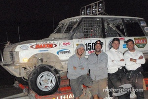Team poses with their Range Rover Classic