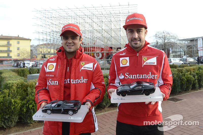 Felipe Massa and Fernando Alonso unveil the new art installation at the Ferrari facility