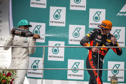 Lewis Hamilton, Mercedes AMG F1 and race winner Max Verstappen, Red Bull Racing celebrate on the podium