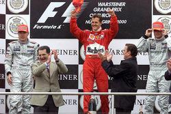 Podium: 1. Michael Schumacher, Ferrari; 2. Mika Häkkinen, McLaren; 3. David Coulthard, McLaren