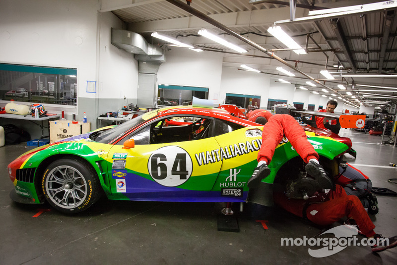 #64 Scuderia Corsa Ferrari 458 in the garage with mechanical issues
