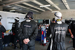 Erebus crew members look on during qualifying