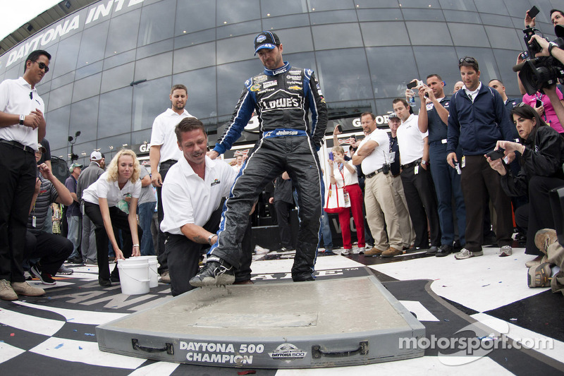 Victory lane: winner Jimmie Johnson, Hendrick Motorsports Chevrolet gets his footprint cast in cement