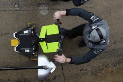 Mercedes AMG F1 mechanic with front pit stop jack