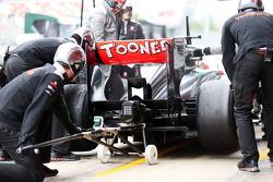 Jenson Button, McLaren MP4-28 practices a pit stop