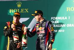 (L to R): Race winner Kimi Raikkonen, Lotus F1 Team celebrates on the podium with Sebastian Vettel, Red Bull Racing