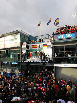 The podium, Ferrari, second; Jenson Button, McLaren, race winner; Fernando Alonso, Ferrari, third