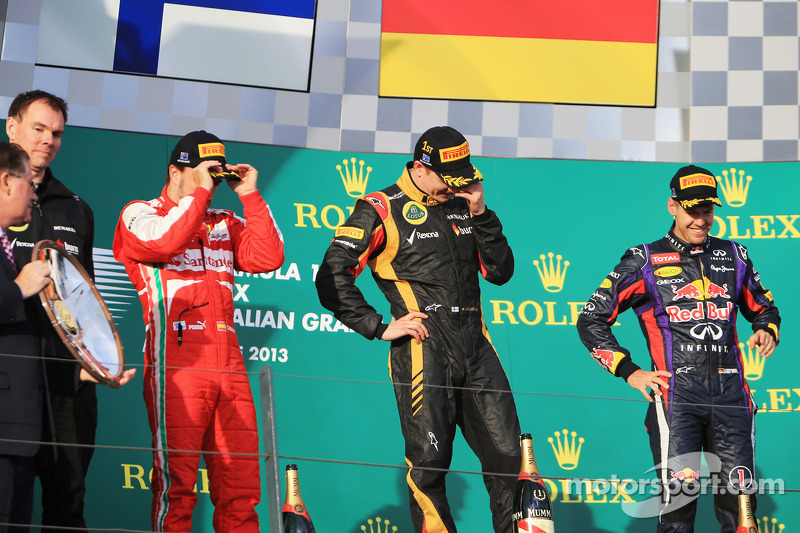 The podium, Ferrari, second; Kimi Raikkonen, Lotus F1 Team, race winner; Sebastian Vettel, Red Bull Racing, third