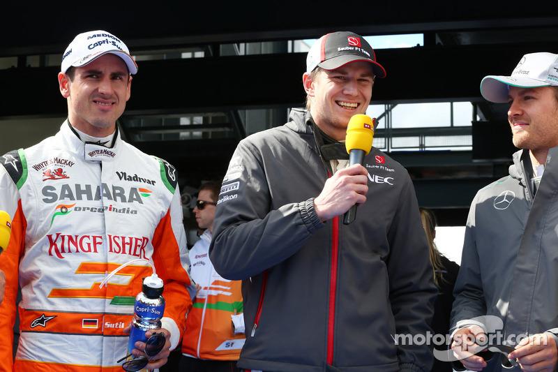 (L naar R): Adrian Sutil, Sahara Force India F1 met Nico Hulkenberg, Sauber en Nico Rosberg, Mercede