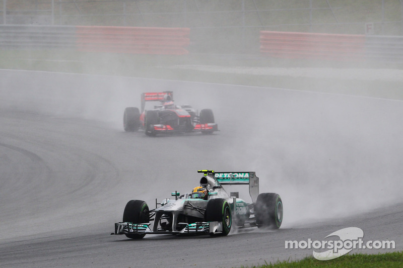 Lewis Hamilton, Mercedes AMG F1 W04 leads Jenson Button, McLaren MP4-28