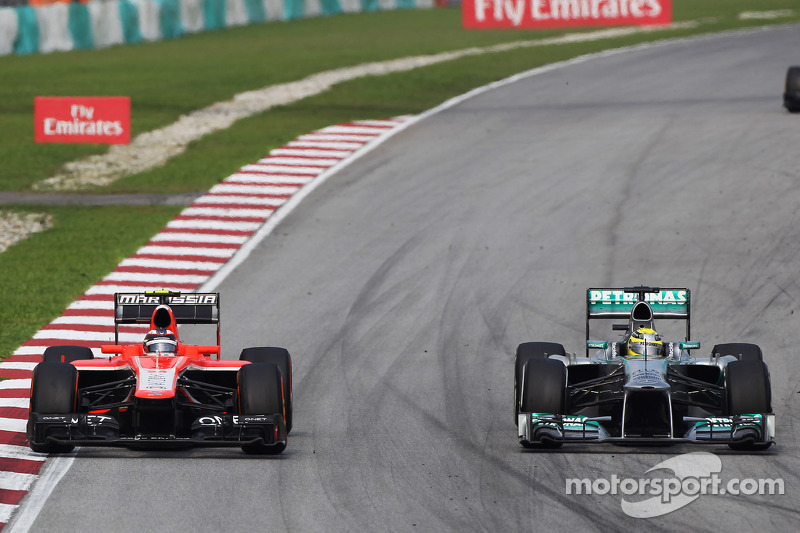 Max Chilton, Marussia F1 Team MR02 and Nico Rosberg, Mercedes AMG F1 W04