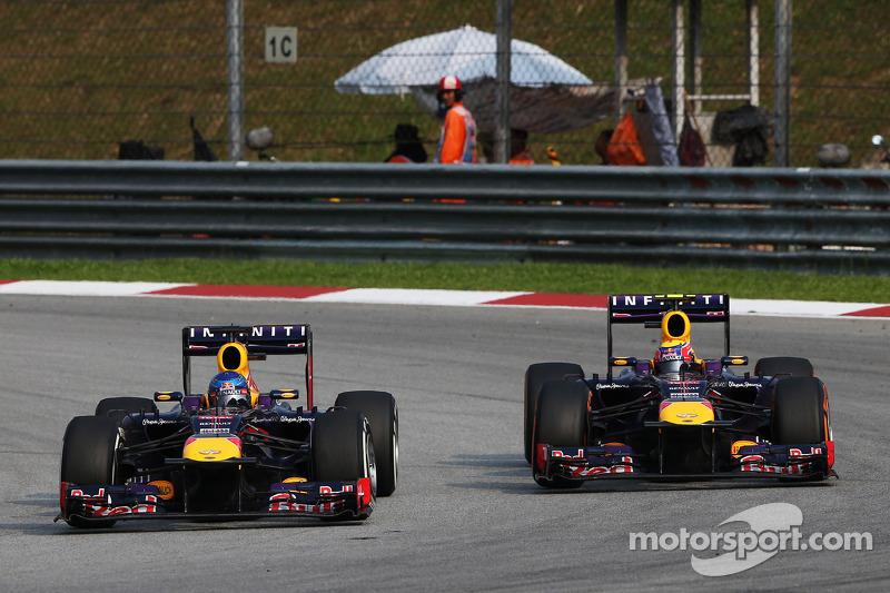 Sebastian Vettel, Red Bull Racing RB9 and team mate Mark Webber, Red Bull Racing RB9 battle for the