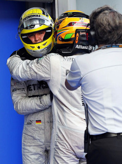 Fourth place Nico Rosberg, Mercedes AMG F1 with third place team mate Lewis Hamilton, Mercedes AMG F