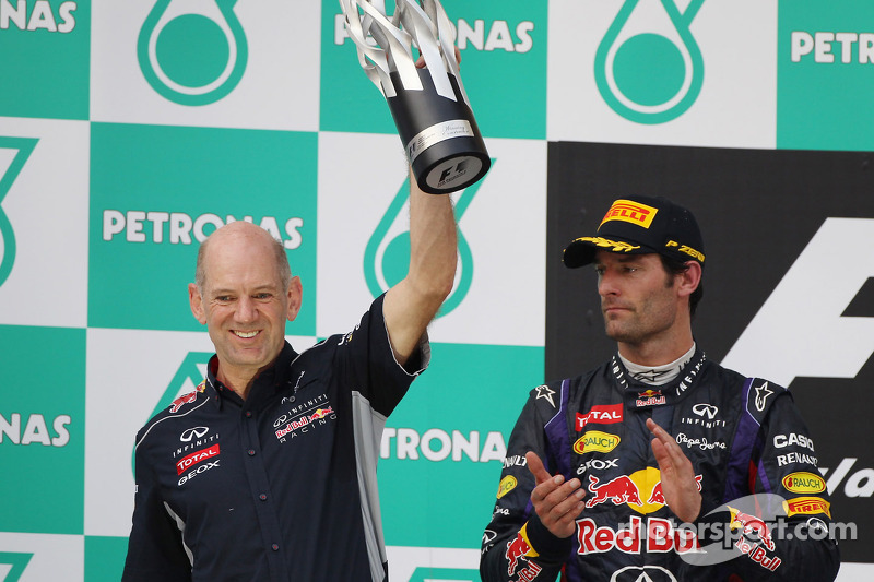 Adrian Newey, Red Bull Racing Chief Technical Officer celebrates on the podium with Mark Webber, Red