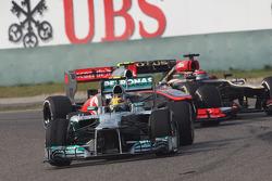 Lewis Hamilton, Mercedes AMG F1 W04 leads Sergio Perez, McLaren MP4-28 and Kimi Raikkonen, Lotus F1 E21