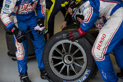 Toyota crew analyzing worn rubber off the #8 Toyota