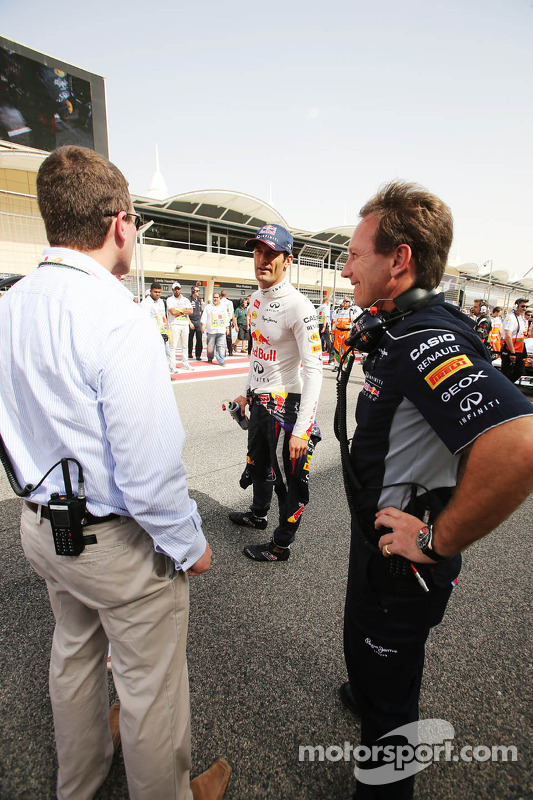 Christian Horner, Red Bull Racing Team Principal and Mark Webber, Red Bull Racing on the grid
