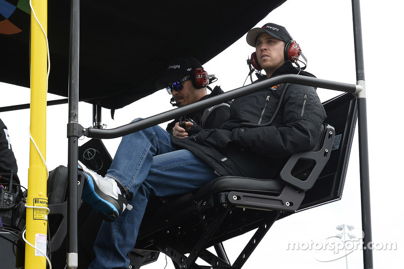 Denny Hamlin looks on from the pits