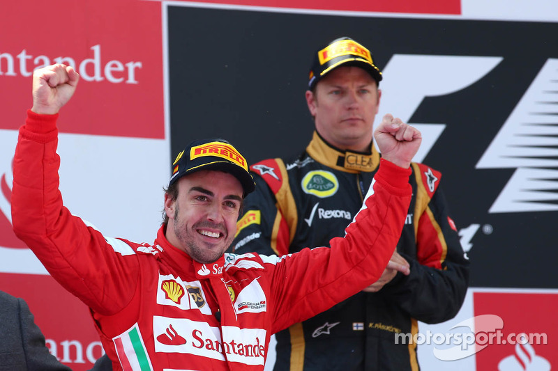 1st place Fernando Alonso, Ferrari F138 and Kimi Raikkonen, Lotus F1 Team