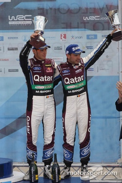 Third place Thierry Neuville and Nicolas Gilsoul, Ford Fiesta WRC, Qatar M-Sport WRT on the podium