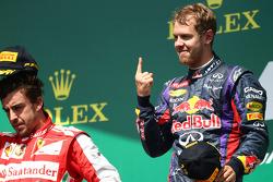 2nd place for Fernando Alonso, Ferrari F138 and 1st for Sebastian Vettel, Red Bull Racing