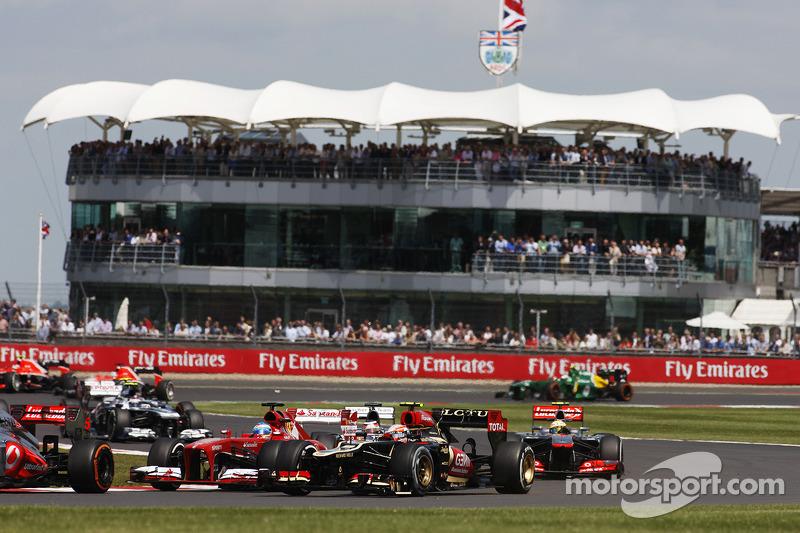 Romain Grosjean Lotus F1 E21 and Fernando Alonso Ferrari F138