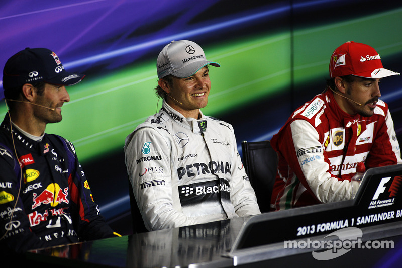 The FIA Press Conference Mark Webber Red Bull Racing, second; Nico Rosberg Mercedes AMG F1, race winner; Fernando Alonso Ferrari, third