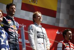 The podium Mark Webber Red Bull Racing, second; Nico Rosberg Mercedes AMG F1, race winner; Fernando Alonso Ferrari, third