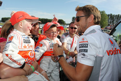 Jenson Button McLaren with young fans