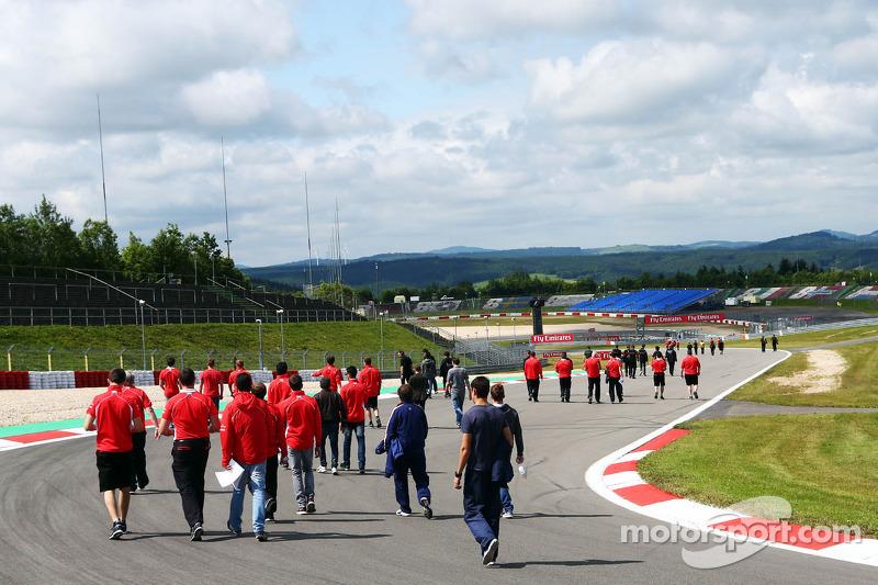 The Marussia F1 Team walk the circuit