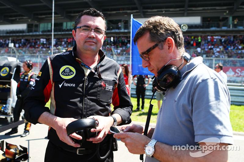 (L naar R): Eric Boullier, Teambaas Lotus F1 met Eric Lux, Genii Capital CEO op de grid
