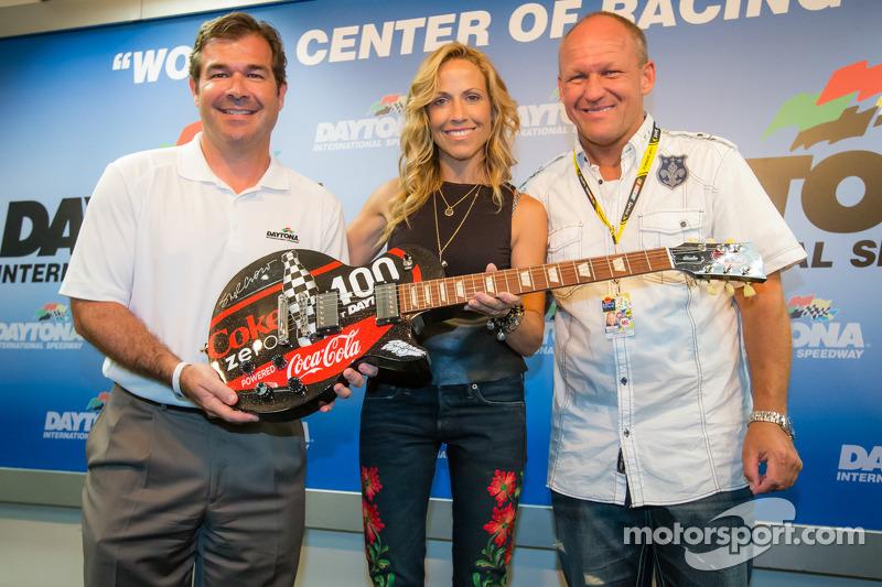 Daytona International Speedway President Joir Chitwood, pre-race concert performing artist Sheryl Crow and guitar designer Sam Bass