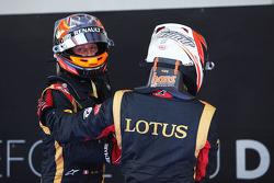(L to R): Romain Grosjean, Lotus F1 Team and Kimi Raikkonen, Lotus F1 Team celebrate in parc ferme
