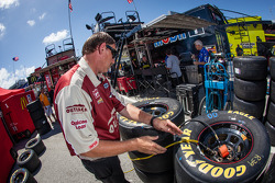 Crew member for Ryan Newman, Stewart-Haas Racing Chevrolet prepares wheels and tires