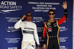 Pole sitter Lewis Hamilton, Mercedes AMG F1 with third placed Romain Grosjean, Lotus F1 Team in parc ferme