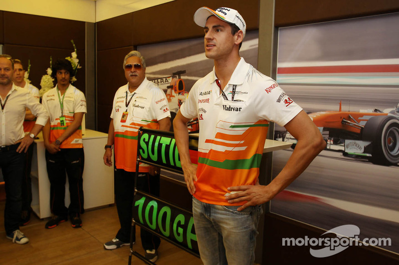 Adrian Sutil, Sahara Force India F1 celebrates his 100th GP with the team