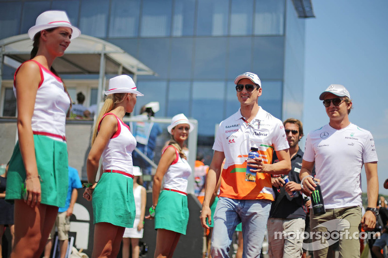 (L to R): Adrian Sutil, Sahara Force India F1 and Nico Rosberg, Mercedes AMG F1 on the drivers parad