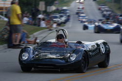 Race cars parade into Elkhart Lake for the Friday concours. #9 191962 Lotus 23B: Rick Balsley