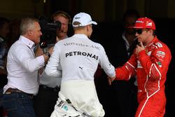 Polesitter Valtteri Bottas, Mercedes AMG F1 celebrates with Kimi Raikkonen, Ferrari in parc ferme as Johnny Herbert, Sky TV looks on