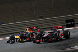 Jenson Button, McLaren MP4-27, leads Sebastian Vettel, Red Bull RB8