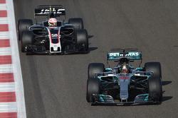 Lewis Hamilton, Mercedes-Benz F1 W08  and Antonio Giovinazzi, Haas F1 Team VF-17