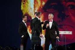 Derek Warwick on stage with Lando Norris