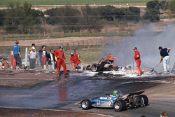 Henri Pescarolo, Matra-Simca MS120 drives past the flame engulfed cars of Jacky Ickx and Jackie Oliver