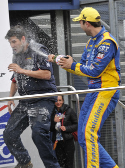 Andrew Jordan sprays team member with Champagne
