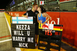 Romance in the paddock as a Red Bull Racing employee accepts a marriage proposal from a Lotus F1 Team employee