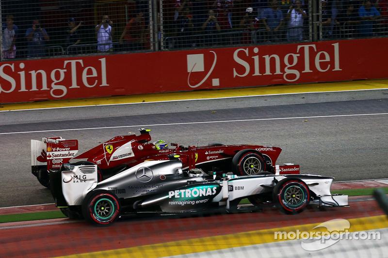 Lewis Hamilton, Mercedes AMG F1 W04 y Felipe Massa, Ferrari F138 en la arrancada