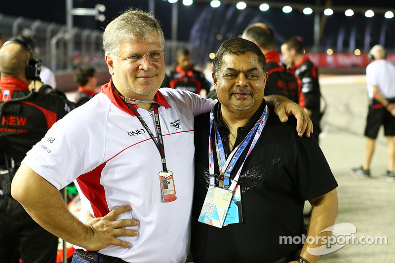 Andrei Cheglakov, Marussia Team Owner with Vijay Eswaran, QI Group Executive Chairman on the grid