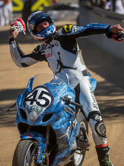 Danny Eslick tossing his gloves into the crowd at the corkscrew