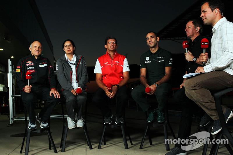 (L naar R): Franz Tost, Teambaas Scuderia Toro Rosso met Monisha Kaltenborn, Teambaas Sauber, Graeme